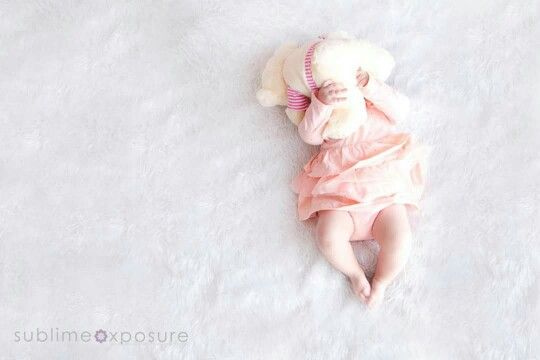 Baby smiles newborn photographer 5 month old girl with teddy wearing peach colour dress