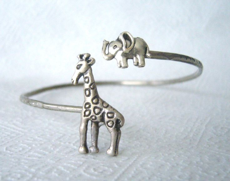 Giraffe cuff bracelet with an elephant wrap style. $24.00, via Etsy.