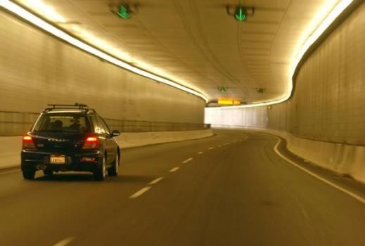 **  FILE ** An automobile passes through the Eisenhower Tunnel on Interstate 70 in this Sept. 21, 2004 file photo, near Silverthorne, Colo. Republican lawmakers in the Colorado State Capitol are promoting a $5 toll on Interstate 70 to pay for the widening of the highway.