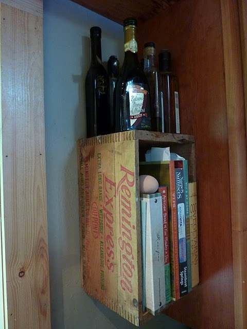 Love this idea of attaching vintage storage crates to the wall for additional shelving....this might just work in the small nook in our kitchen for cookbooks, etc