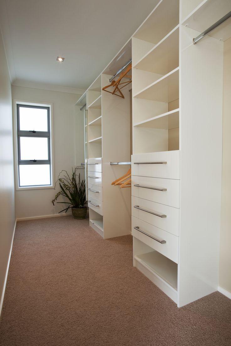 Master bedroom walk in wardrobe. Huge space and natural light!