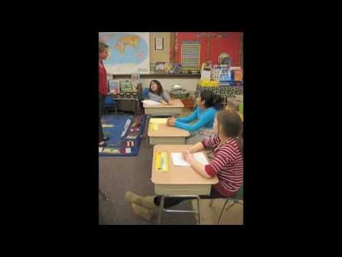 BJM autism video modeling raising hand to answer a teacher's question