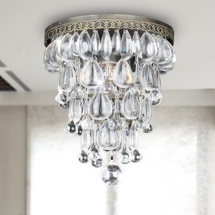 This crystal ceiling chandelier will be the focal point of any room with its elegant and unique crystal cone shape and antique copper finish. Decorative details strengthen the character of this brilliant chandelier. It is available in blue or brown.