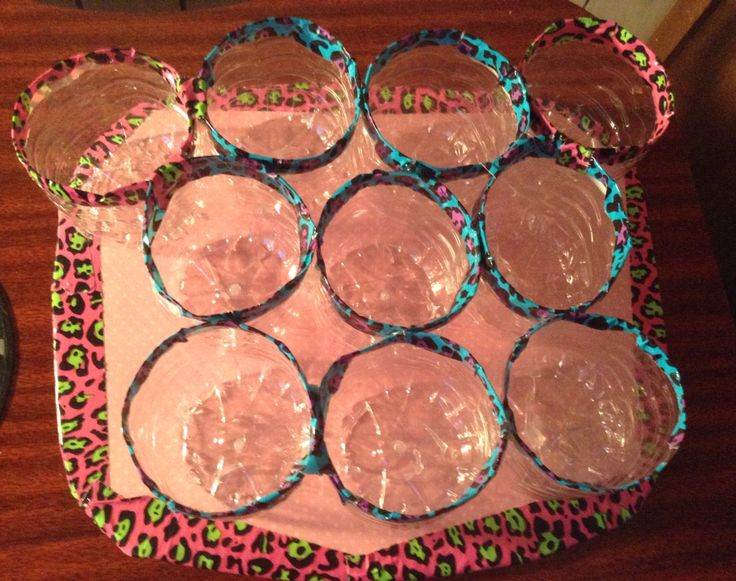 Recycle water bottles holders with duct tapes.