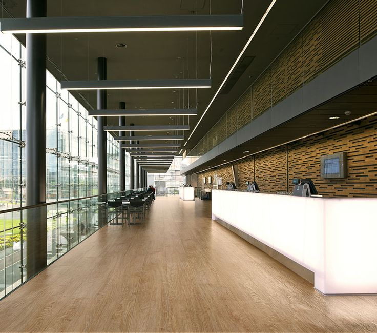 Slimtech Wood-Stock: the Slimtech slab wood look laminated porcelain UGL, with 5.5mm thickness, treated with Microban® antimicrobial protection.