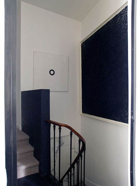 A staircase with contemporary artwork.