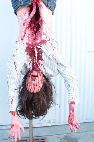 Hanging gutted gory female body prop. Great for haunted houses or horror movies.