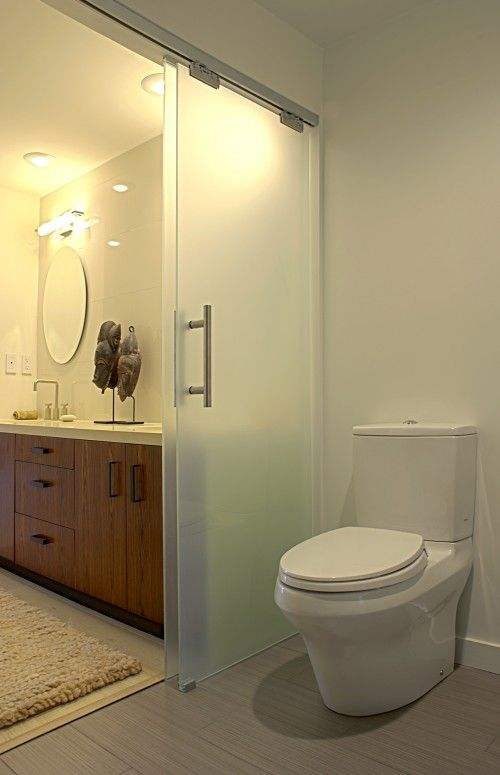 imagine family of 4 and 1 bathroom...solution... sliding doors inside the bathroom