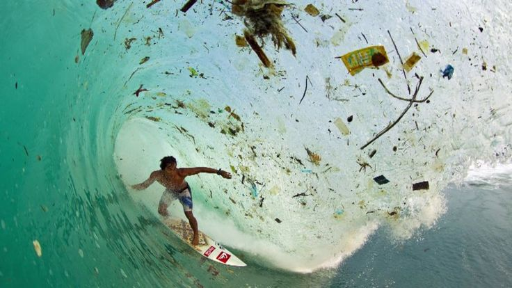 Zack Noyle's famous surfer in a wave of dirt – What if we could take all that plastic and turn it into fashion?