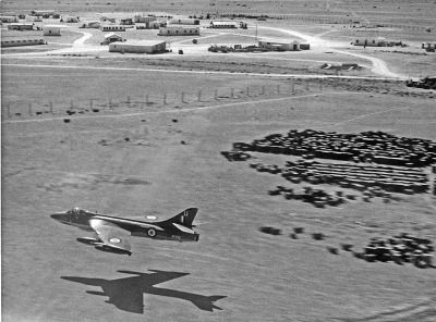 "Low pass. ""How low can you go! XF436-U about to wake RAF Masirah from its slumbers, 1962 (Sandy Burns)"""