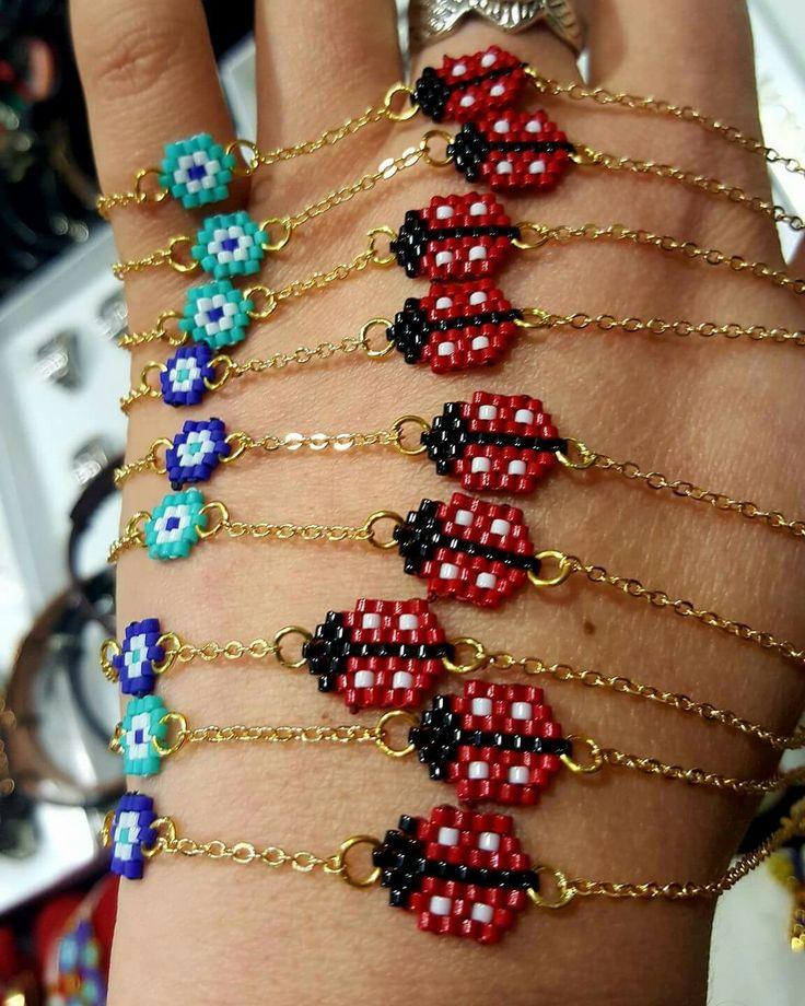 Beaded ladybug and flower bracelet