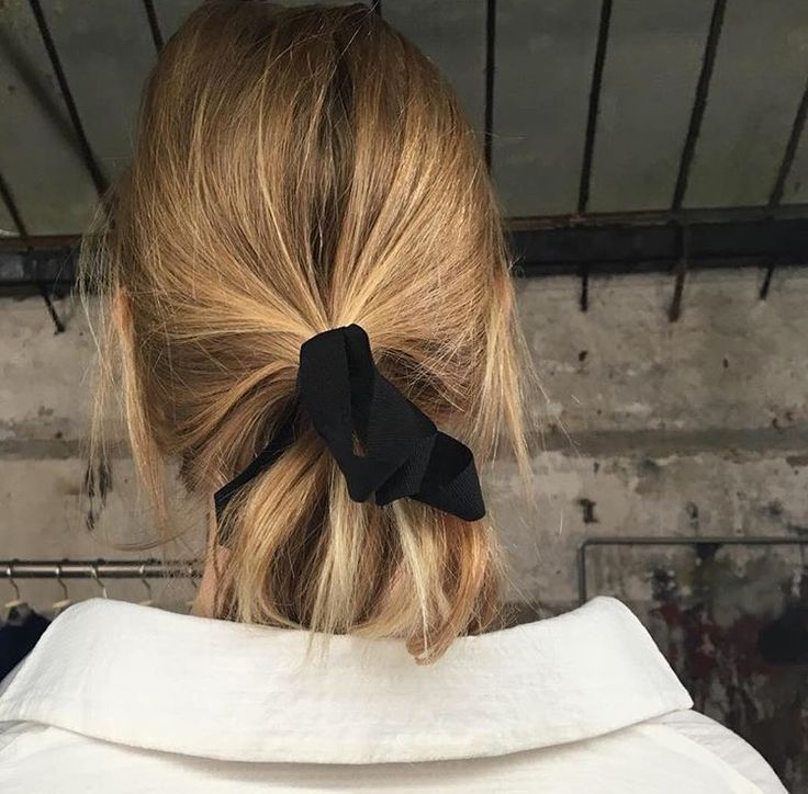 black ribbon in the hair...