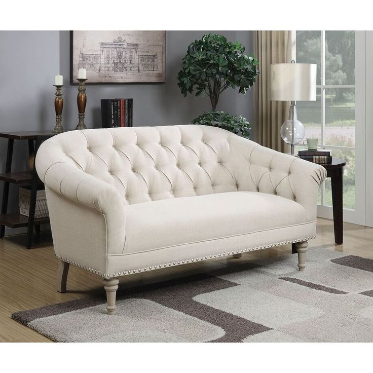Elegant and refined, this settee will add a touch of sophistication and classic refinement to your home. The sofa features a rounded back with button-tufted linen upholstery. The turned legs feature a chic grey finish.