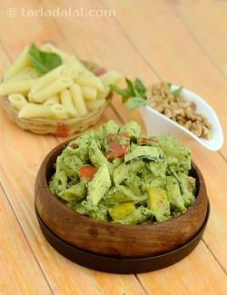 A traditional Italian sauce, Pesto features a rare combination of walnuts or pine nuts with basil leaves and olive oil. While some versions use garlic, the Jain version is much tastier. In this mouth-watering recipe of Pesto Penne, we combine this delectable sauce with perfectly cooked penne, a basketful of colourful veggies, aromatic herbs and oodles of cheese, to make a treat worthy of a grand party, a special dinner with your family, or any day you feel like pampering yourself!