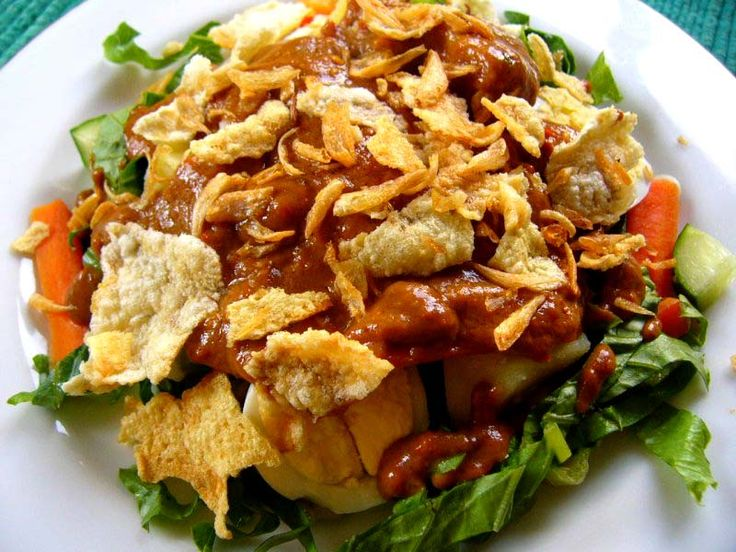 Jakarta Gado-gado.  It is a delicious, unique and healthy food. It is a mix of vegetables served with peanut sauce. The common ingredients for this meal are water spinach, bean sprouts, boiled egg, chayote, tofu and tempe (fermented soybean patty) and poured by peanut sauce.
