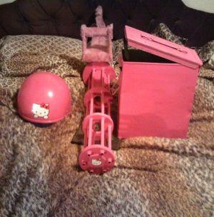Hello Kitty Gatling Gun ~ I will be doing all my zombie apocalypse shopping at the Hello Kitty store ^_^