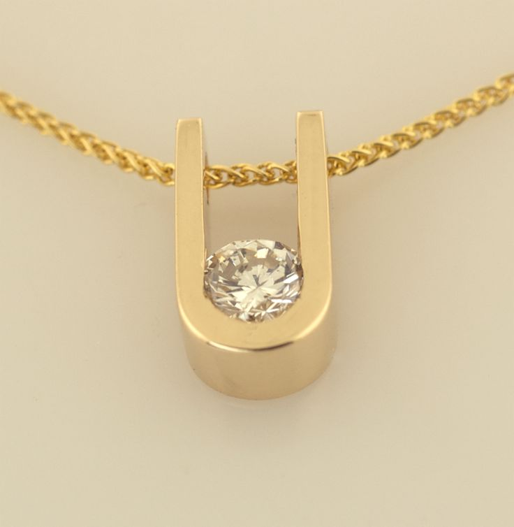 ©2013 Thomas Michaels, 14KT yellow gold pendant set with a .50ct. round brilliant shaped diamond on a 14KT yellow gold wheat chain.