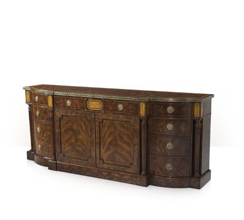 A fine mahogany veneered and yew burl banded buffet, the break bowfront top with an ebony and brass inlaid edge, above an arrangement of four frieze drawers and central cabinet doors enclosing an adjustable shelf, flanked by two sets of three graduated  drawers and turned and tapering columns, on line strung plinth base.