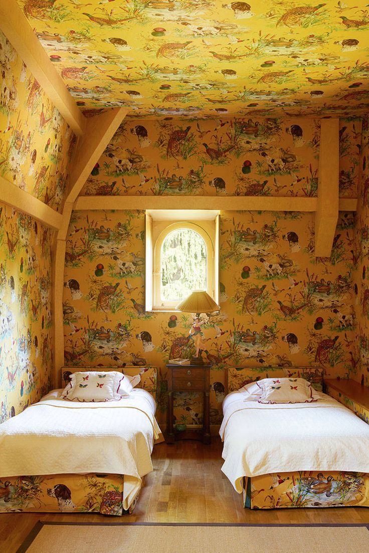 Children's guest room w/ Pierre Frey fabric in Agnès Monplaisir's country estate, photo Simon Upton for Harper's Bazaar.