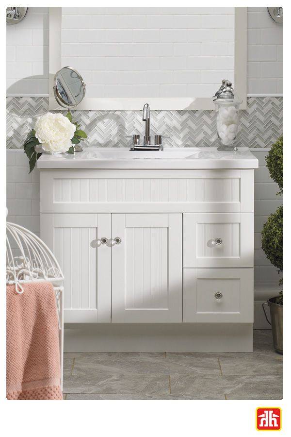 This classic white vanity has a clean look and plenty of storage.