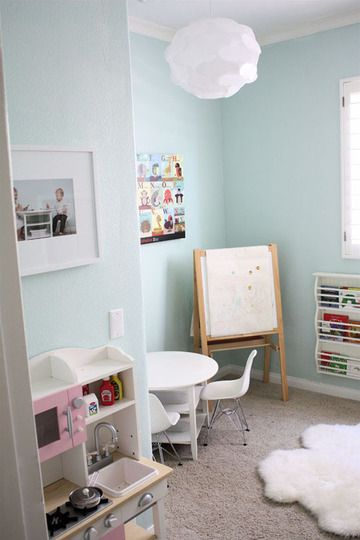 Cool playroom! Like the color and the bookshelves from Ikea stacked.