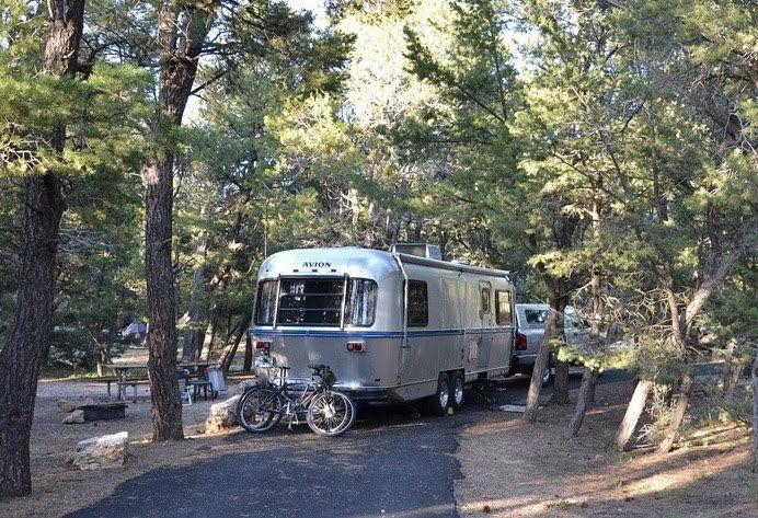 Mather Campground - No hook-ups - 30-foot trailer or RV maximum Open year-round. Operated by the National Park Service and located in Grand Canyon Village, this campground offers tent and RV camping. Accessible campsites and restrooms are available. Pets are allowed, but must be leashed at all times, and may not be left unattended. Wood and charcoal fires permitted in provided campsite grills only. No gathering of down wood, wood may be purchased at the general store. Laundry and showers…