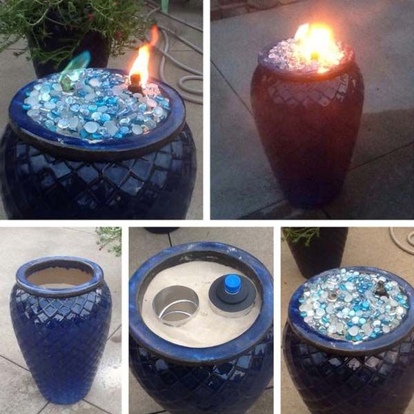 #1. Fill the pot with sand, and create a backyard fireplace.(Made this fire pot using a ceramic flower pot, sand to fill the pot, two pieces of metal ductwork, two tiki torch canisters and topped it off with glass beads! You could also use river rocks!)