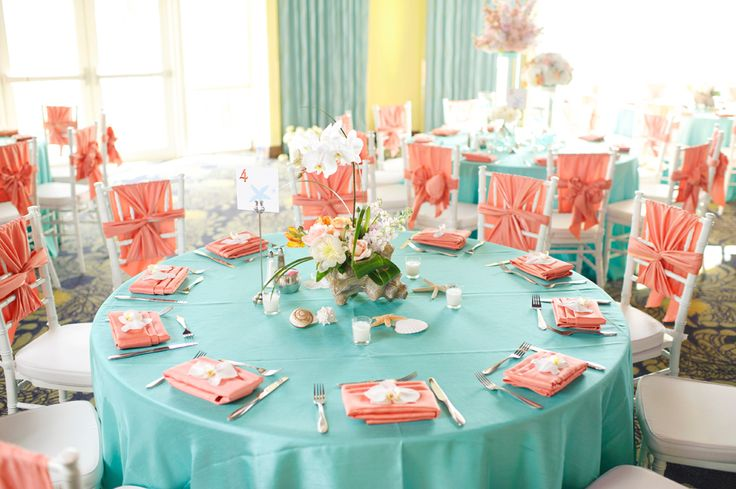 teal and peach colors- love the chiavari chairs with chair tie