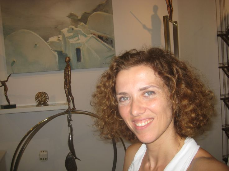 Flora Koutsi. Co-founder of Oia Treasures Art Gallery. Beware! She can go on about contemporary art at great length.