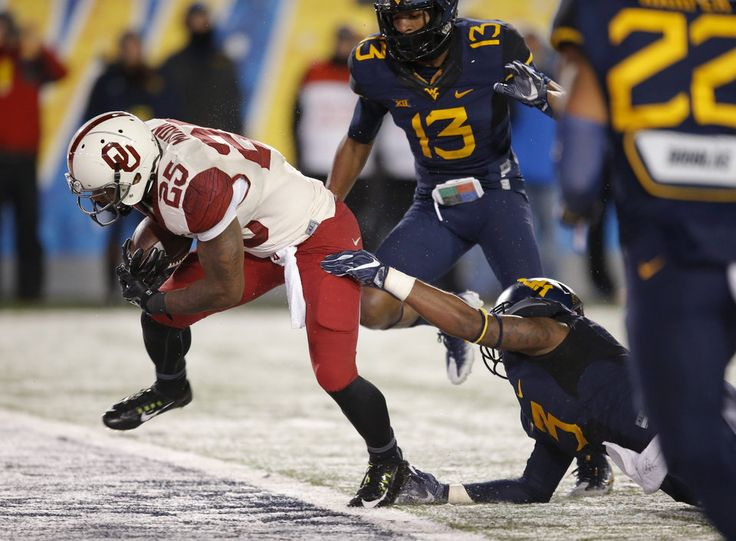 Oklahoma's Joe Mixon (25) scores a touchdown in front of West Virginia's Al-Rasheed Benton (3) and Rasul Douglas (13) during a college football game between the University of Oklahoma Sooners (OU) and and the West Virginia University Mountaineers (WVU) on Mountaineer Field at Milan Puskar Stadium in Morgantown, W. Va., Saturday, Nov. 19, 2016. Photo by Bryan Terry, The Oklahoman