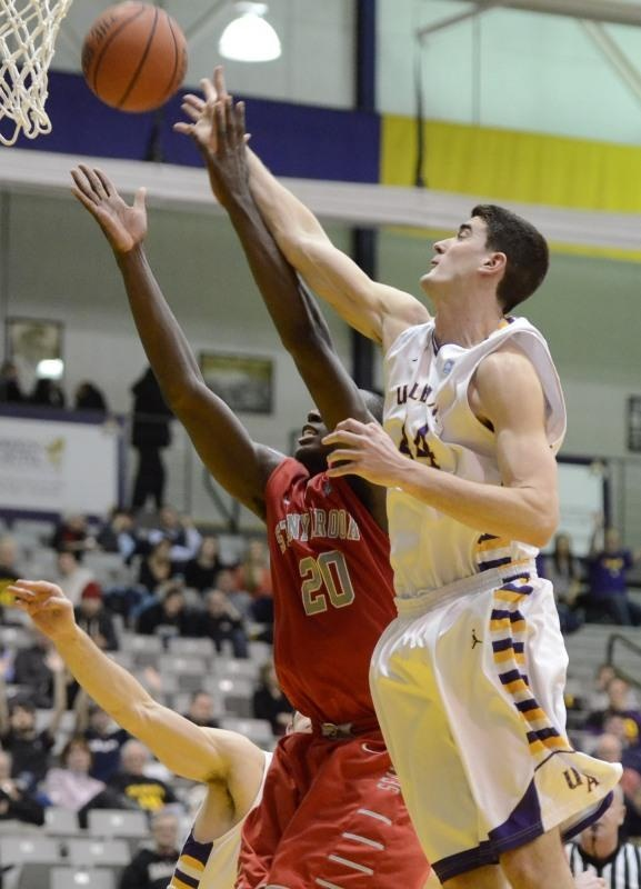 UAlbany's John Puk (44) battles for a rebound during a recent America East game against Stony Brook at SEFCU Arena. (J.S. Carras/The Record)