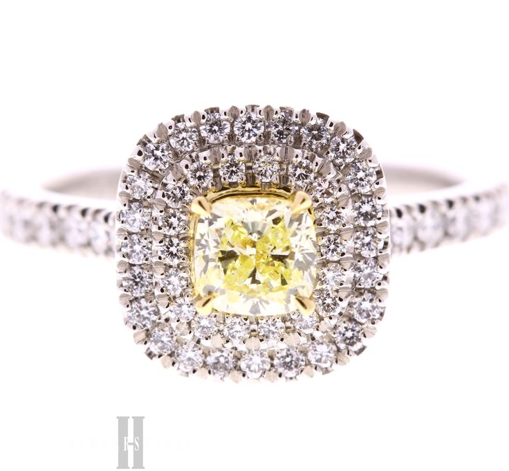 Natural yellow diamond with double halo and diamond shoulders in platinum