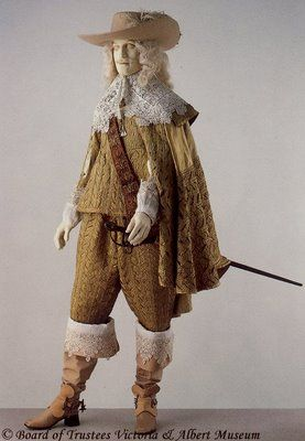 1630. V Cavalier look. Plumed hat with brim cocked, Doublet, falling collar and lace cuffs, baldric, shoes with bows, venetians/slop breeches, boot hose, gauntlet gloves.
