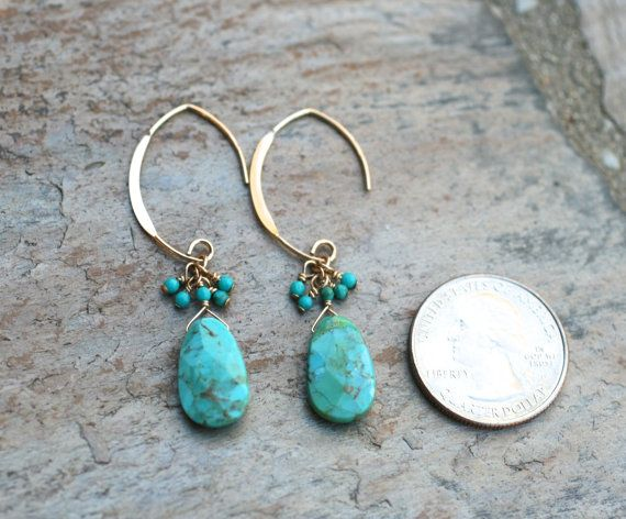 Two Kingman turquoise ovals are wire wrapped and dangle from large 14KT gold filled marquis shaped ear wires. Tiny turquoise beads wire wrapped at the tops of the ovals. Simply stunning and unique. Versatile, modern and well made! Earring length: 2 L Turquoise oval size: 15mm Please note