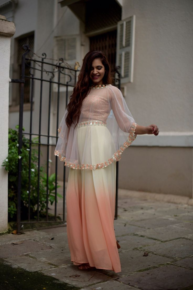 love the blouse with transparent cape