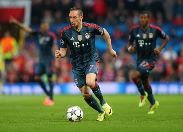 Franck Ribery of Bayern Muenchen runs with the ball during the UEFA Champions League Quarter Final first leg match between Manchester United and FC Bayern Muenchen at Old Trafford on April 1, 2014 in Manchester, England. - 86 of 102