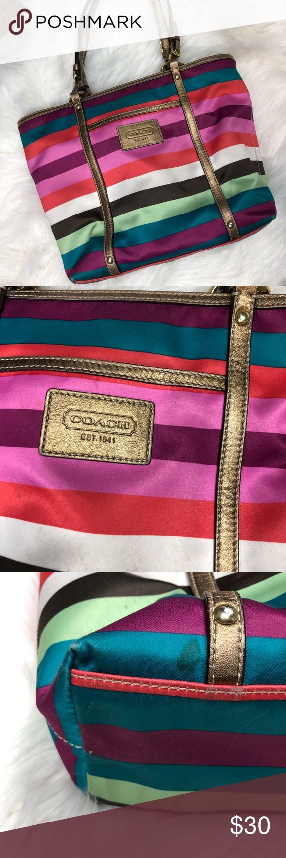 """COACH LEGACY MULTI STRIPE SATIN TOTE multi-colour stripe metallic bronze leather trim zip top closure front zip pocket leather patch with COACH EST. 1941 brass  hardware COACH hangtag and decorative brass button interior slip pockets interior zip pocket D ring to hang accessories or key fob khaki satin lining Coach creed and serial number measures approx. 12.5"""" (L) x 10"""" (H) x 4"""" (W) please view all photos this is a great bag from a smoke free home with a few blemishes to the bottom corners…"""