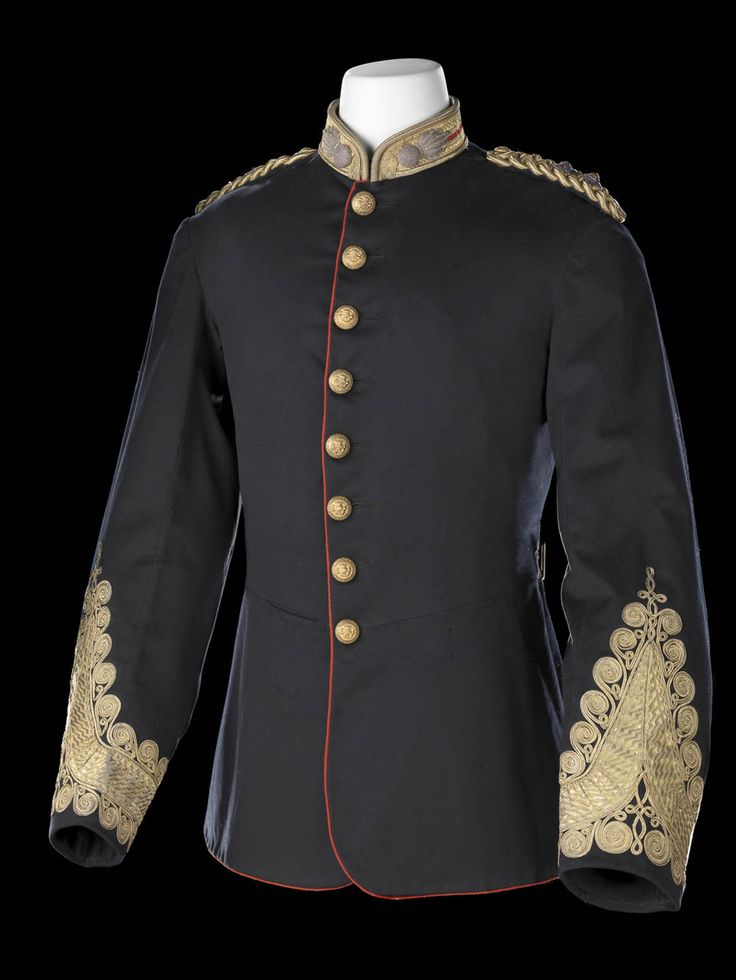 Tunic of Lieutenant-Colonel E.C.L. Durnford, Royal Marine Artillery. The tunic is of blue wool and has a standup collar of buckram faced with red wool and edged with gold lace.  There is a silver threadwork badge of an exploding grenade on either side of the collar which is for Artillery. Both shoulders have plaited gold shoulder straps with rank badges. The tunic is single-breasted and closes with eight gilt brass buttons with Royal Marines Artillery insignia.