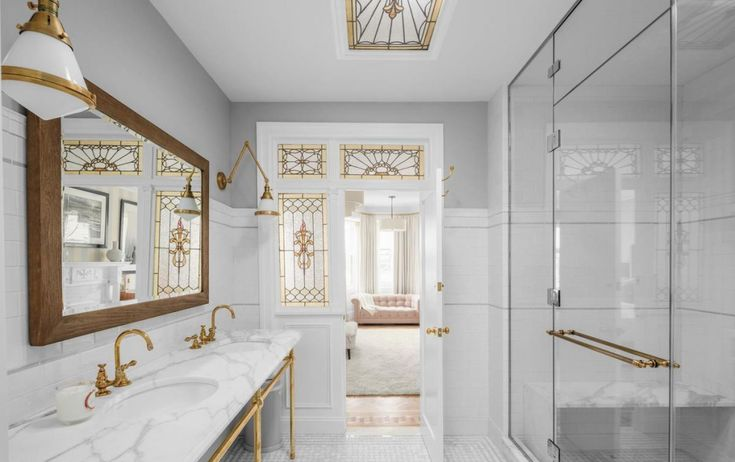 Brass Faucet | Marble Bath | Console Sink | Brass Legs | Traditional Bath | Modern | Stained Glass | Emily Blunt and John Krasinski | LOCATION: Brooklyn, NY PRICE: $8,000,000 SIZE: (approx.) 5,200 square feet, 4-7 bedrooms, 3.5 bathrooms brass circa lighting Gale library wall lights  metal sink base legs