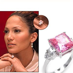 "J Lo's Pink Diamond Engagement Ring -Did you know that she had received number of engagement rings which are completely fails? She is most popular celebrity in the field of best personalities having healthy butts. She has received a beautiful pink shaded ring by her fiancée named ""Ben Affeck"" which get lots of cares and reward by viewers. She had worn it for a couple of times but it was busted when she was cut-off from Ben Affeck."