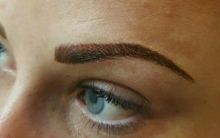 Cosmetic tattoo eyebrow enhancement