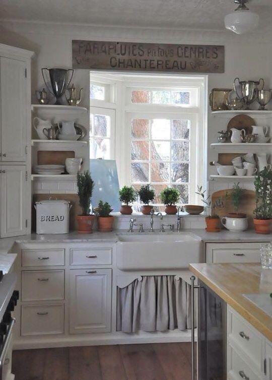 Image from http://static.eatwell101.com/wp-content/uploads/2013/03/kitchen-window-with-glass-shelves.jpg.