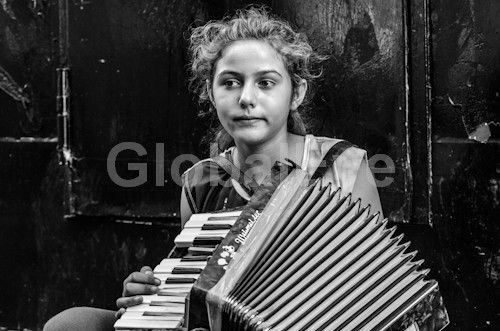 gypsy girl . youg Turkish girl playing accordian. Photograph By Andy J Collins #PeoplePhotography