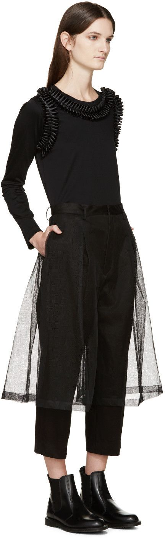 Noir Kei Ninomiya T-shirt noir à manches longues et boucles à volants