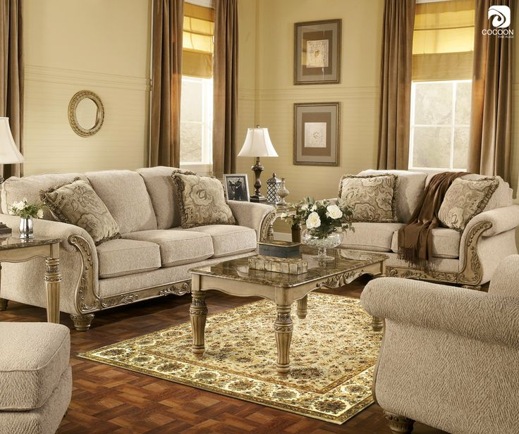 The colors in the floral print on the rug can be used to create the room's color scheme.  The background color or one of the light, neutral colors of the print can be repeated on the walls and other furnishings such as drapes, solid-colored upholstery, etc.
