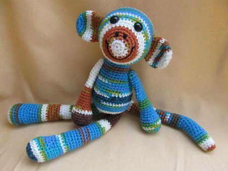 One skein crochet monkey pattern by CraftyDebDesigns.