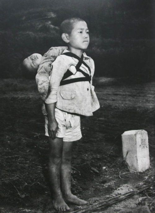 Real-life Grave of the Fireflies: (Photo) Stoic Japanese orphan, standing at attention having brought his dead younger brother to a cremation pyre, Nagasaki, by Joe O'Donnell 1945    The sad story in the comments. :(