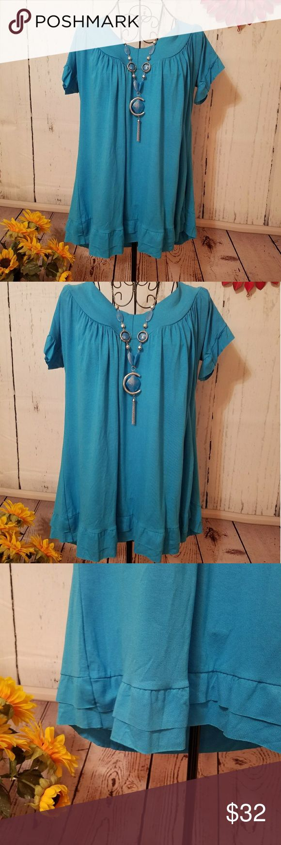 "Brand New GORGEOUS Sea Blue Gypsy tunic top XXL SUPER cute top with layer ruffle at bottom raw and so cute! and slight ruffle to short sleeves.  Gorgeous color deep sea blue! 98% viscose & 2% elastane. JERSEY SOFT! Thin and cool with stretchy to it. Adorable ""scoop drop neck""design which is a slight rounded V neck. Beautiful and flowy!Necklace is included if wanted.  Underarm to underarm is 20 in, lenght top of shoulder to bottom hem 28.5 in. THESE DO NOT HAVE SIZE TAGS. PLZ Check…"