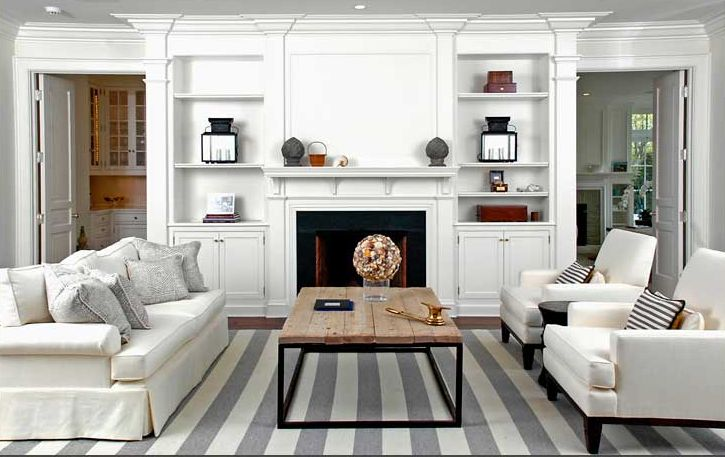 Brooks & Falotico: Cozy living room with white & gray striped rug, brickmaker's coffee table, white sofa & ...