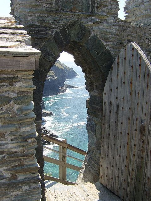What a gorgeous view awaiting this entrance to Tintagel Castle, Cornwall.   Built in 1233, Tintagel Castle is set high on the rugged North Cornwall coast.